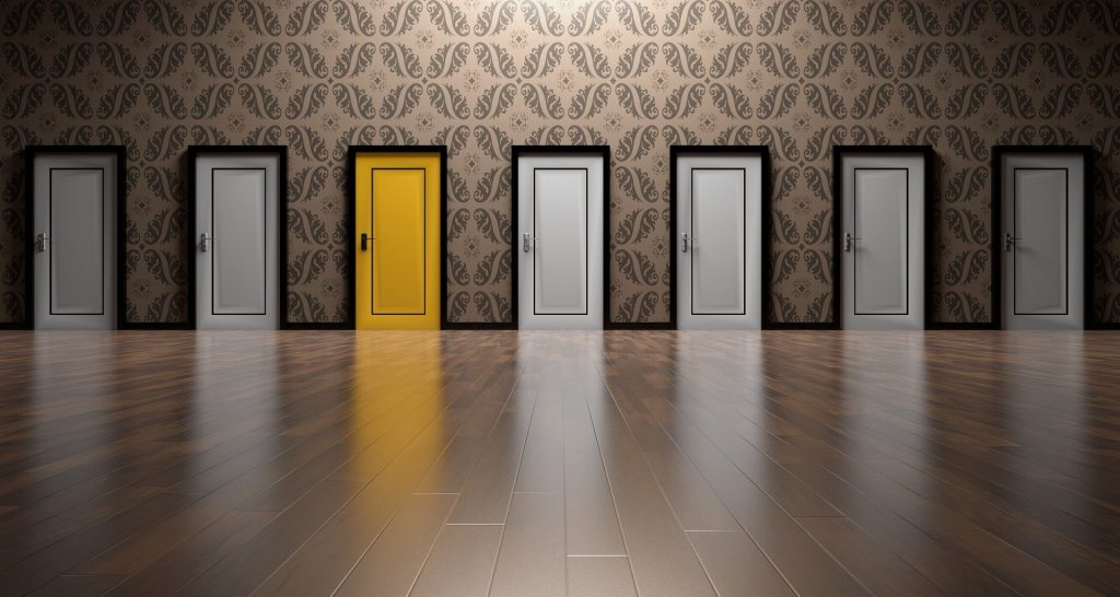 A row of doors with one highlighted in yellow to symbolize opportunity.