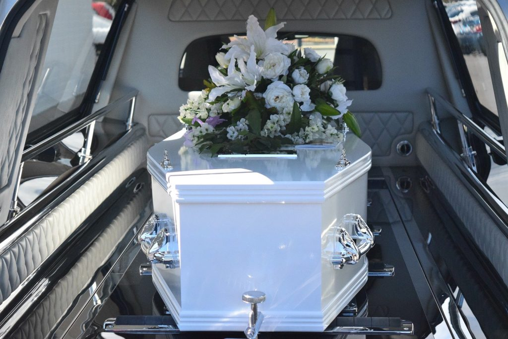 A funeral resting in the back of a hearse.