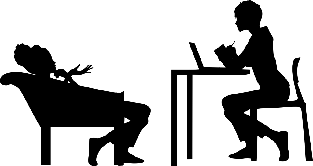 A silhouette depicting a patient and therapist conversing.