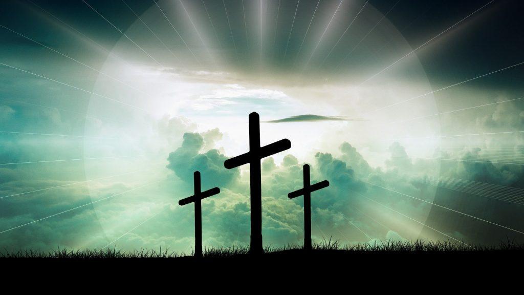 Three crosses on a hill.