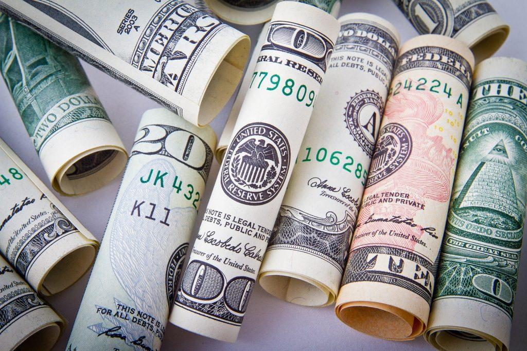 Rolled-up money bills.