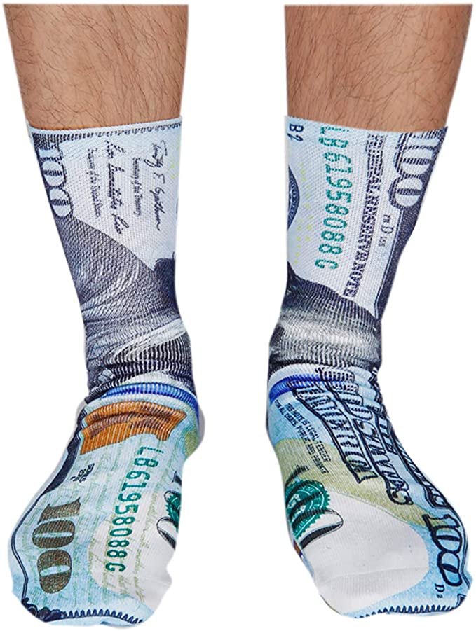 A pair of socks with the U.S. $100 bill printed on them.