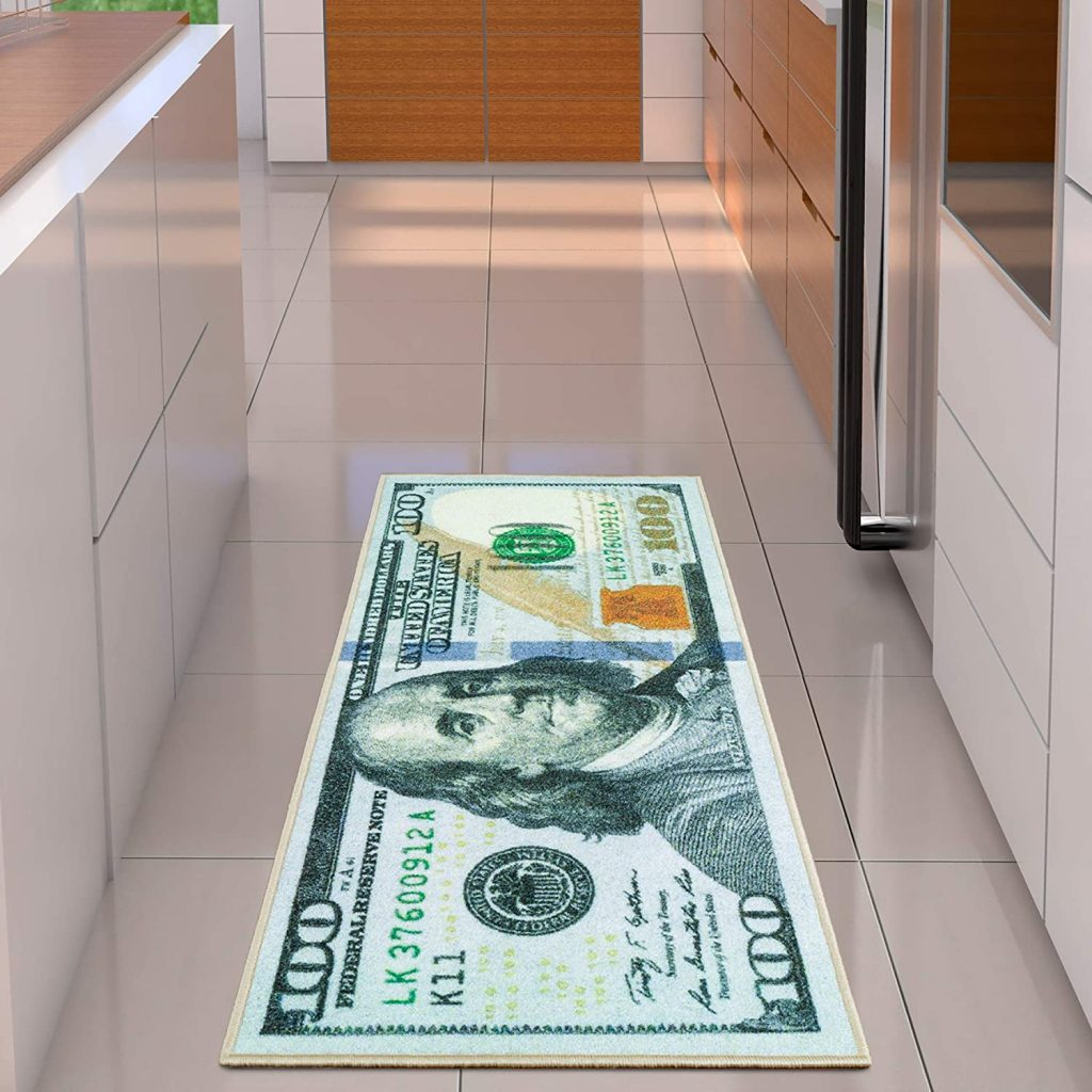 A runner rug with an enlarged $100 bill printed on it.