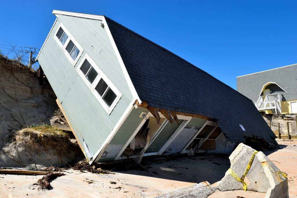 A house laying on its side after a landslide.