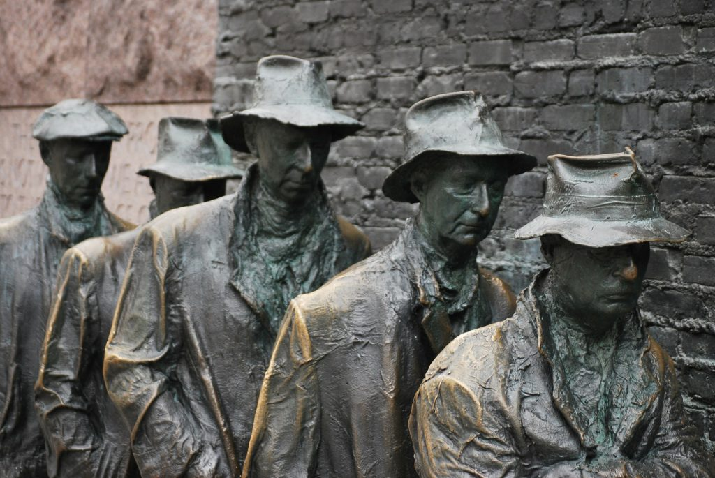 Statues forming a breadline.