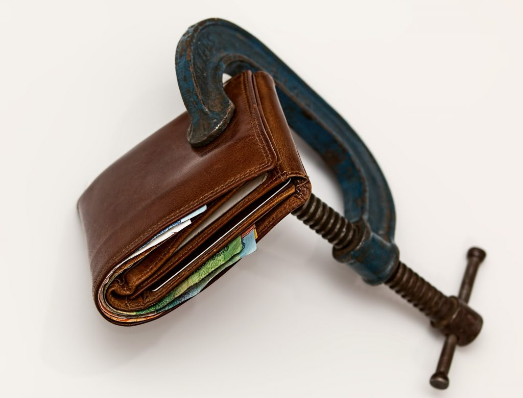 A wallet in a vice.